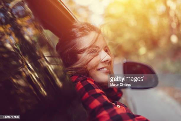 Woman on a road trip with car