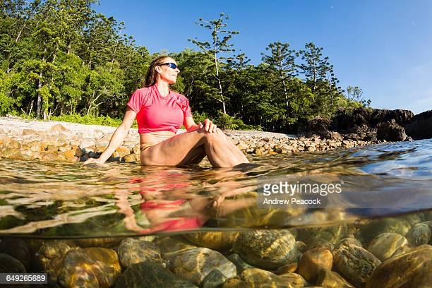 A woman on a rocky beach, Perseverance Island