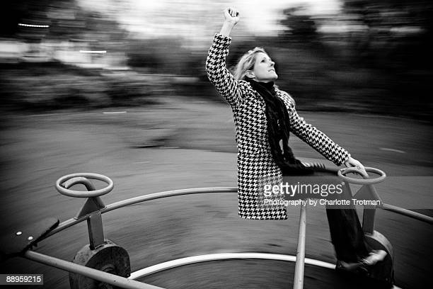 woman on a roundabout in black and white