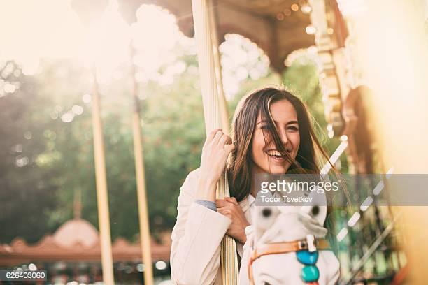 woman on a roundabout - 1 woman 1 horse fotografías e imágenes de stock