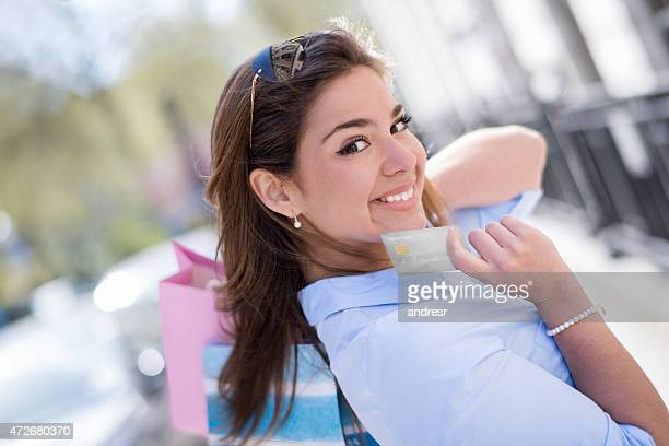 Woman on a shopping spree with a credit card