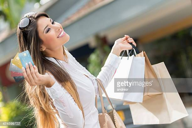 Woman on a shopping spree with credit cards