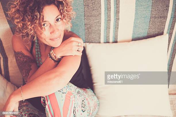Woman on a sofa smiling