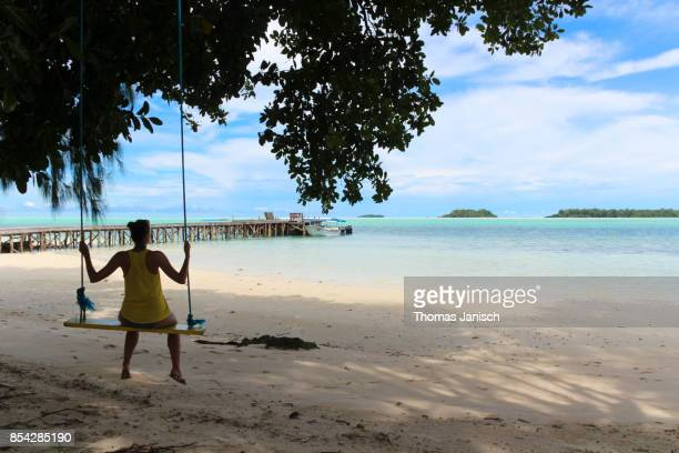 Woman on a swing at the beach, Palau