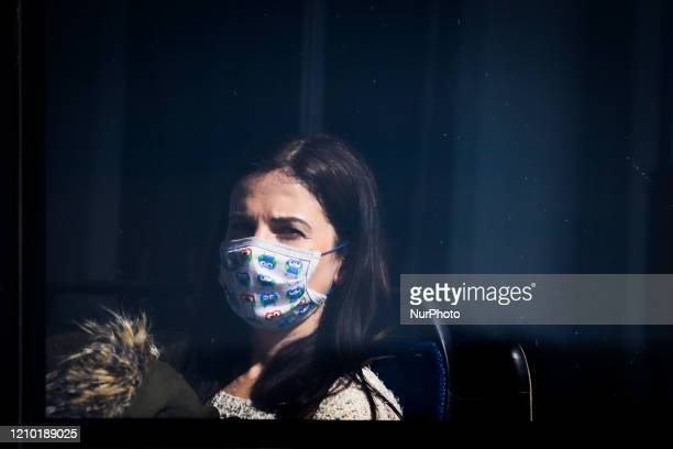 A woman on a tram wears a protective face mask due to the spread of coronavirus Krakow Poland on April 16 2020 The rule of covering the nose and...