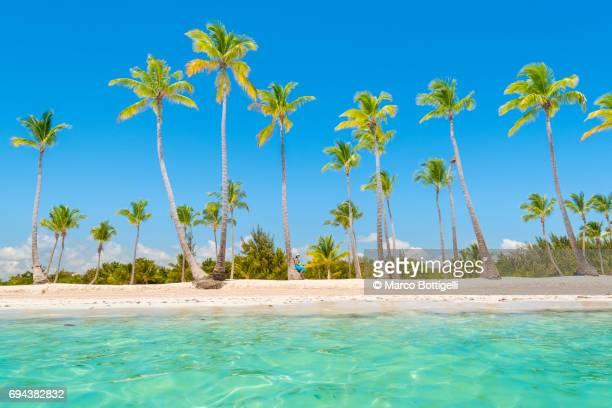 Woman on a tropical beach. Caribbean Sea.