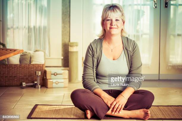 woman on a yoga mat at home