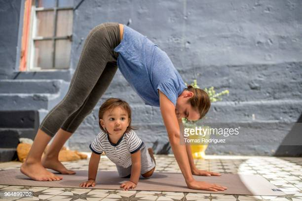Woman on a yoga mat with a toddler boy