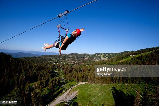 Woman on a zip line smiling