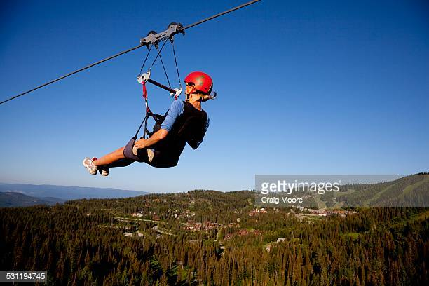 A woman on a zip line tour in Whitefish, Montana.