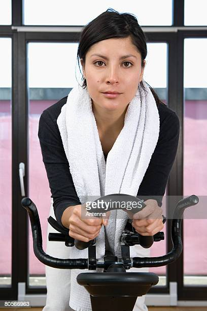 A woman on an exercise bike