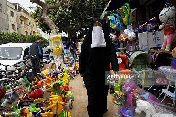 A woman on April 9 wearing a djellaba through the market Madina Jadida and with a veil around the mouth