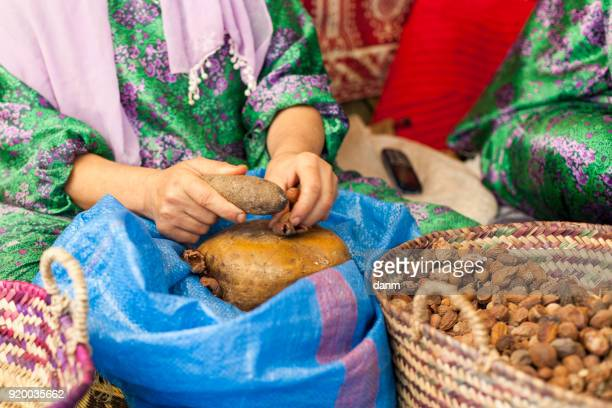 woman on argan oil factory in morocco - argan tree stock pictures, royalty-free photos & images