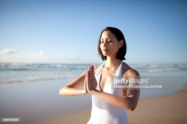 Woman on Australian beach doing yoga