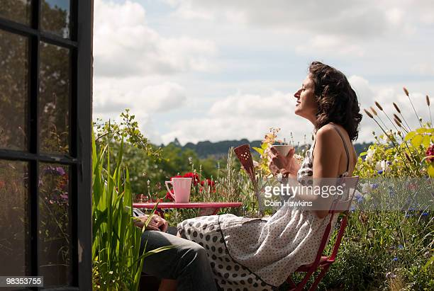 woman on balcony drinking tea