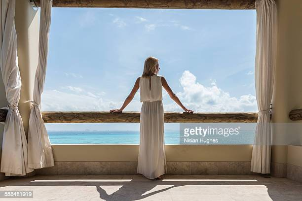 woman on balcony looking out at the ocean