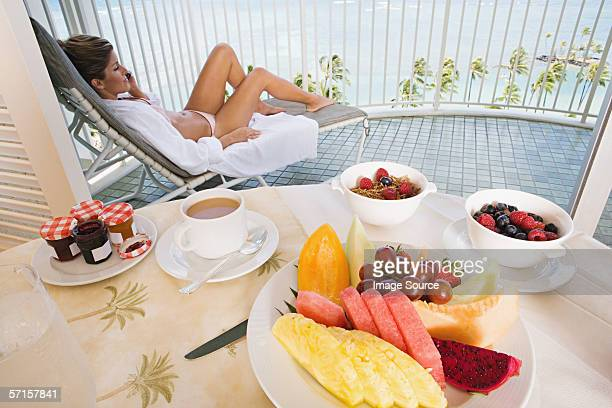 woman on balcony with breakfast - woman leg spread stock photos and pictures