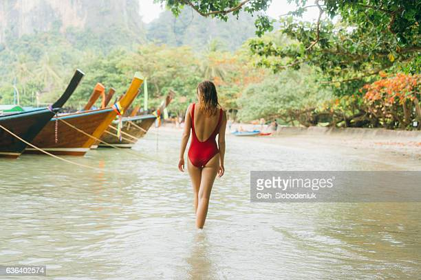 woman on beach in thailand - one piece swimsuit stock pictures, royalty-free photos & images