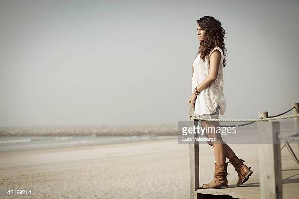Woman on beach looking at horizon