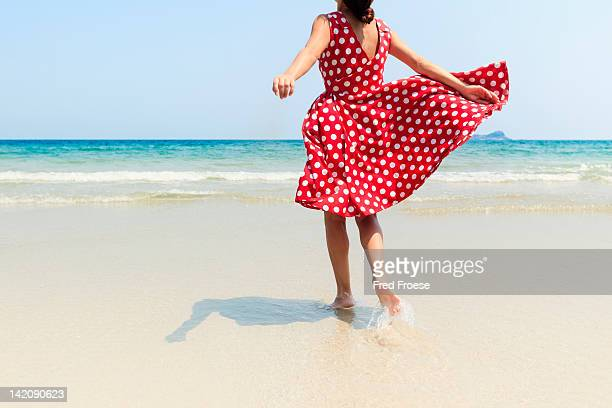 woman on beach - sundress stock pictures, royalty-free photos & images