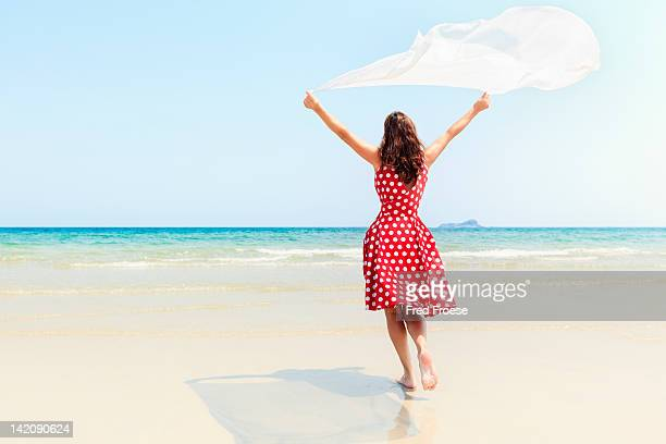 woman on beach - サンドレス ストックフォトと画像