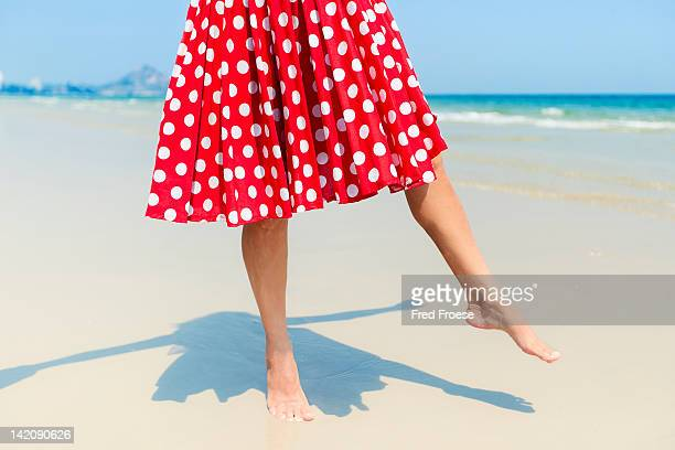 woman on beach - polka dot stock photos and pictures