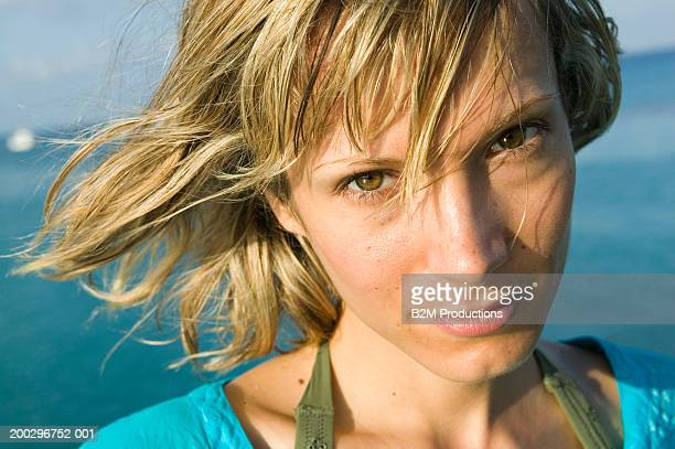 woman on beach, smiling, portrait, close-up - hazel eyes stock pictures, royalty-free photos & images