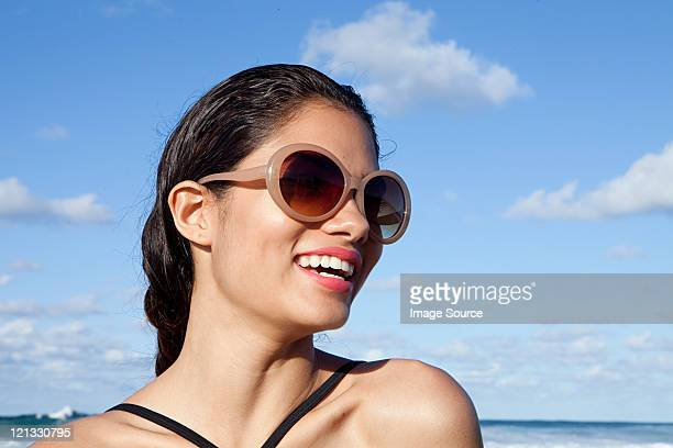 woman on beach wearing sunglasses - beautiful puerto rican women stock photos and pictures