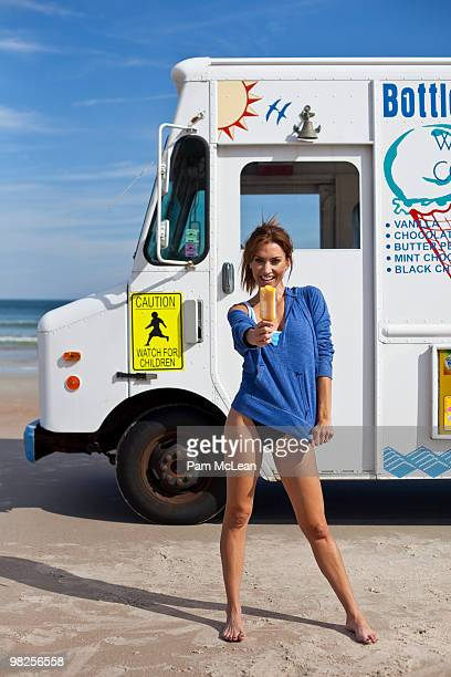 Woman on beach with ice cream
