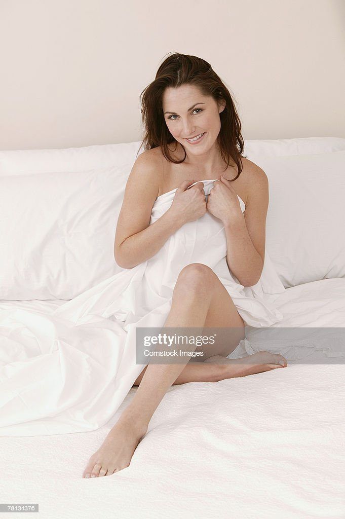 Woman on bed : Stockfoto