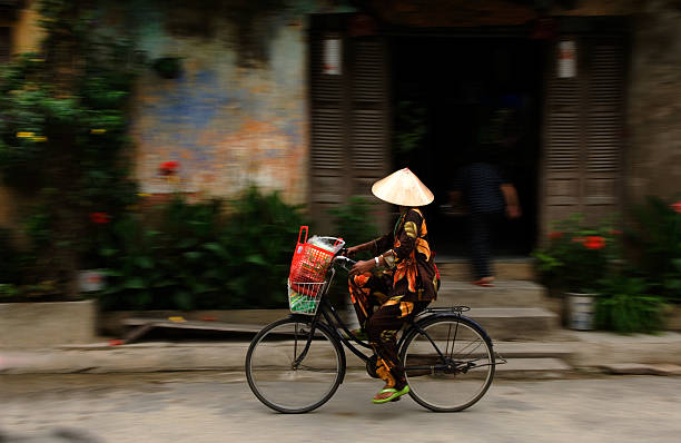 Woman on bicycle, Hoi An, Vietnam