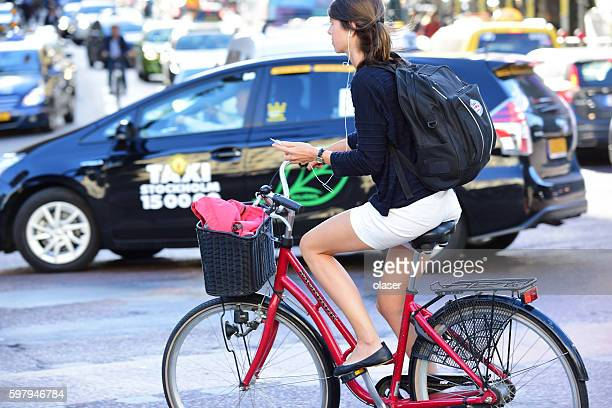 Woman on bicycle in profile