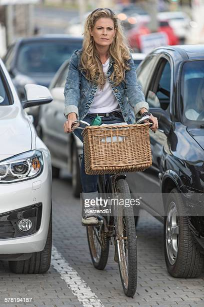 Woman on bicycle in traffic jam