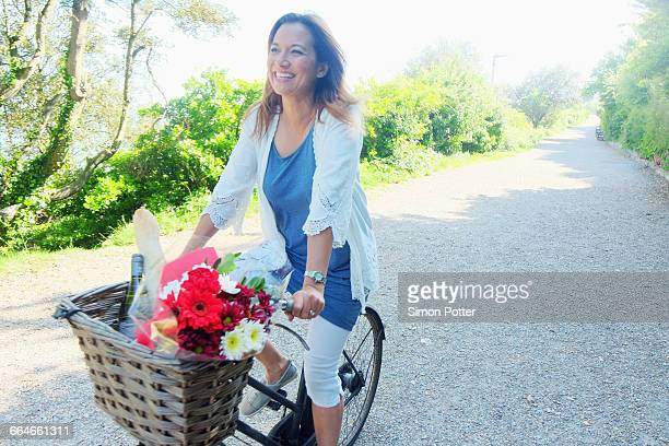 Woman on bicycle looking away smiling