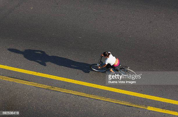 Woman on bicycle on a street of Havana