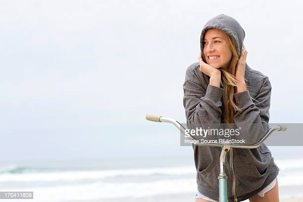 Woman on bicycle on beach