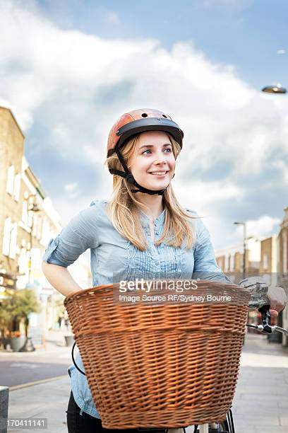 Woman on bicycle on city street