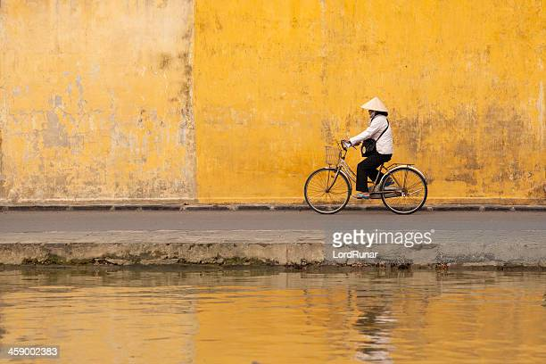 woman on bicycle - traditionally vietnamese stock pictures, royalty-free photos & images