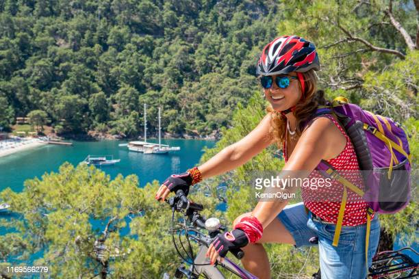 woman on bicycle tour. - aegean turkey stock pictures, royalty-free photos & images