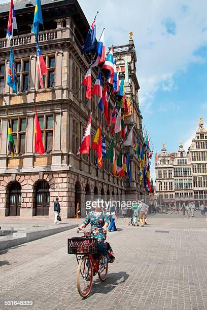 Woman on bike outside Antwerp City Hall