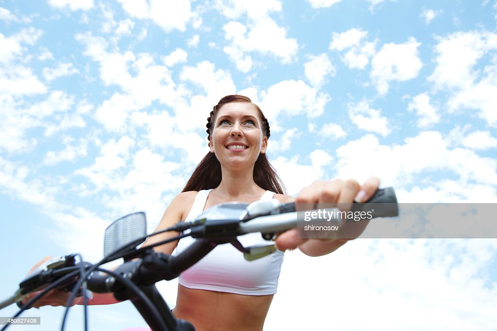 Woman on bike : Stock Photo