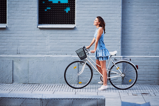 Woman on bike trip in the city during summer 937262154