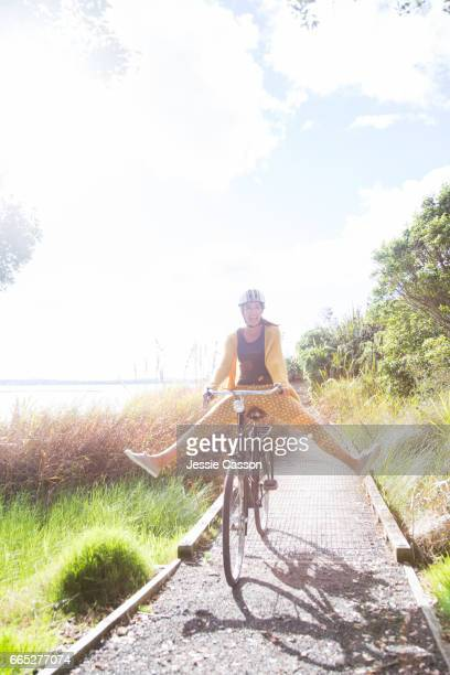 woman on bike with legs apart off pedals