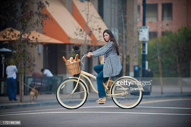 woman on bike with loaves of fresh bread