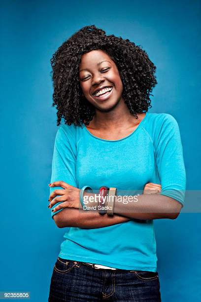 woman on blue - woman blue background stock pictures, royalty-free photos & images