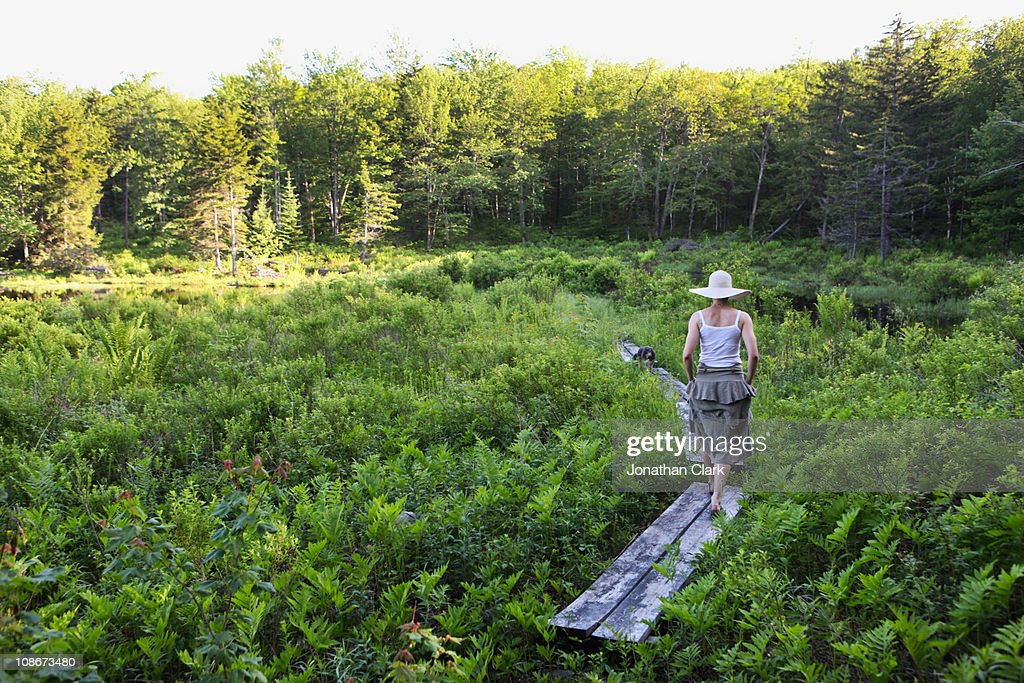 Woman on Boardwalk : Stock Photo