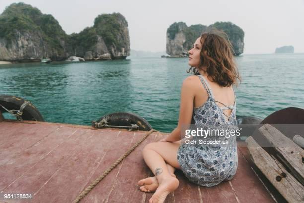 Woman  on boat at Halong Bay