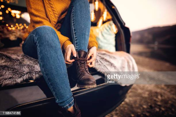 woman on camping in nature - ankle boot stock pictures, royalty-free photos & images