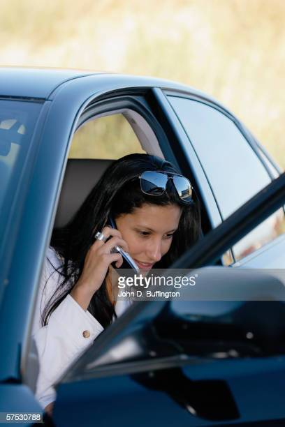 Woman on cell phone in car