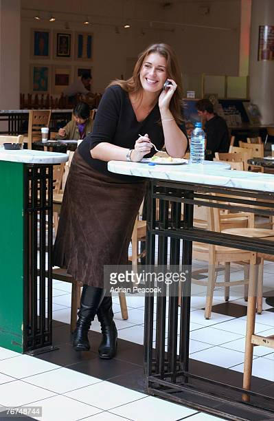 Woman on cell phone in mall food court